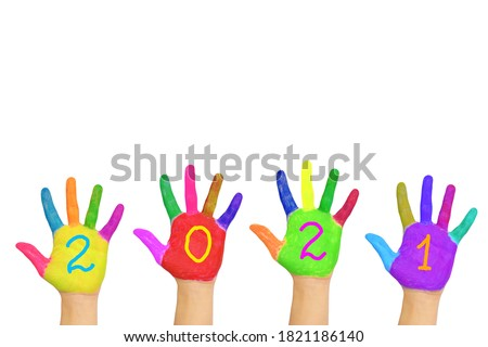 Happy new year! The number 2021 written on the painted hands. New Year and holiday concept. Colorful palms, people are celebrating holidays. Isolated on a white background.
