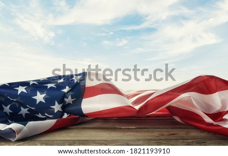 USA  flag on the table against the background of the sky.