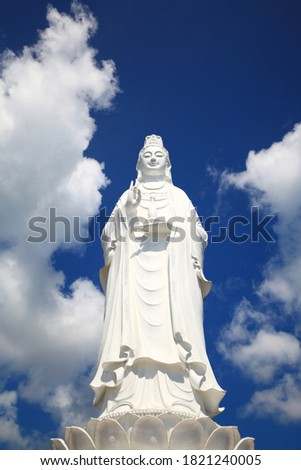 A large white Buddha in Danang marble moutain. A picture taken from the bottom angle.