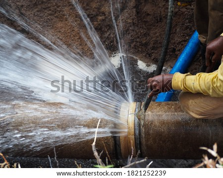 The main pipe is broken or burst pipe and is being repaired Royalty-Free Stock Photo #1821252239