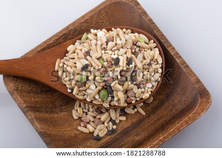 various cereals, seeds, beans and grains on white background. Royalty-Free Stock Photo #1821288788