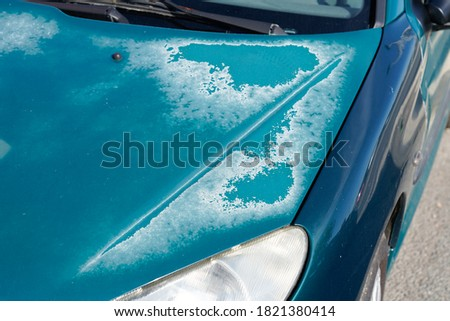 old car bonnet engine hood blue green used paint faded grunge on front  Royalty-Free Stock Photo #1821380414