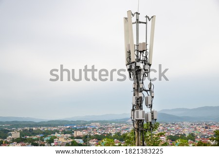 Telecommunication tower with 5G cellular network antenna on A town in the valley background Royalty-Free Stock Photo #1821383225