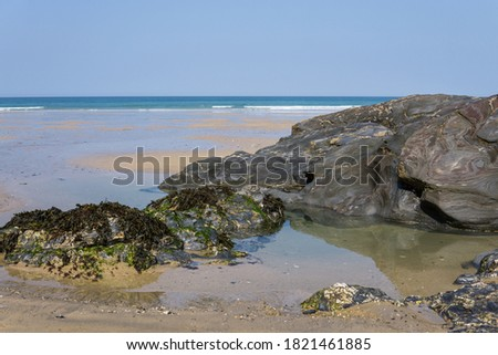 Rock formations on Towan beach Newquay Royalty-Free Stock Photo #1821461885