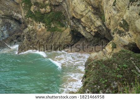 Small cove between Great Western and Tolcarne beaches at Newquay Royalty-Free Stock Photo #1821466958