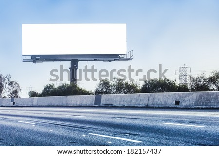 Big white billboard on highway.