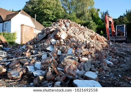 Pile of rubble resulting from the demolition of a house Royalty-Free Stock Photo #1821692558