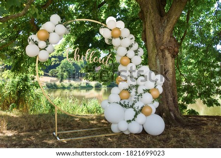 modern wedding arch, inflatable balloons. inscription in gold chillout Royalty-Free Stock Photo #1821699023