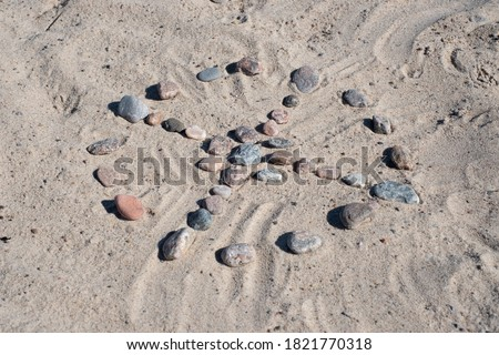Medicine wheel. Native American circle stone pattern with spokes to cardinal directions. Spiritual concept. Royalty-Free Stock Photo #1821770318