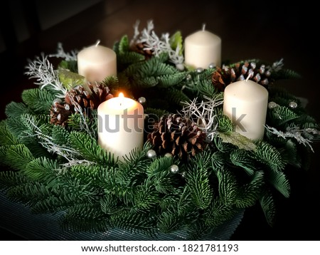 First lit candle on Advent wreath Royalty-Free Stock Photo #1821781193