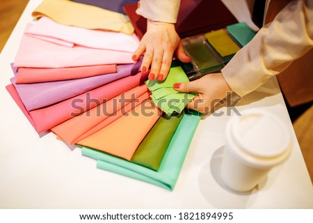 the stylist conducts a color type procedure for a woman,personal consultation about color in clothing Royalty-Free Stock Photo #1821894995