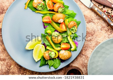 Salad with snails,spinach, tomato and pepper.Healthy vegetable salad #1821938831