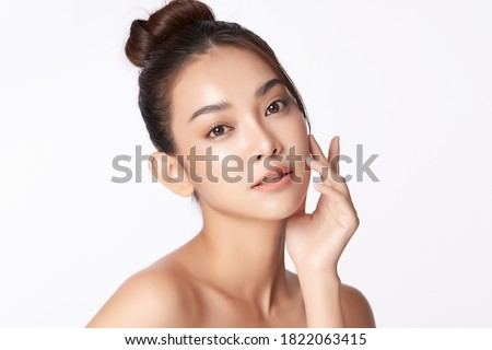 Beautiful young asian woman with clean fresh skin on white background, Face care, Facial treatment, Cosmetology, beauty and spa, Asian women portrait Royalty-Free Stock Photo #1822063415