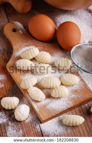 pile of potato dumplings on wooden chopping board #182208830