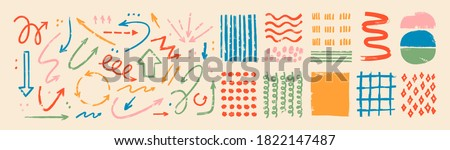 Various sketchy Doodle Arrows, Direction pointers Shapes and Objects. Freehand colorful Lines, curves, dots, spiral. Brush stroke style. Grunge texture. Hand drawn abstract Vector set Royalty-Free Stock Photo #1822147487