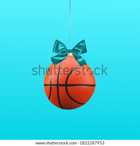 Basketball Christmas ball for tree ornament on a blue color background.