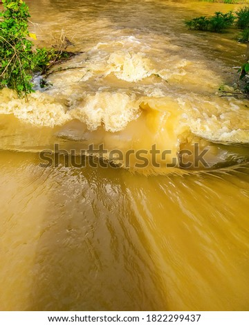 Water flood after heavy rain in odisha, india . Brown color water flowing