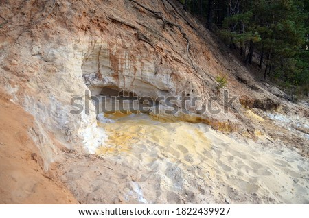 Layers of colored sand. Snow white quartz sand. Shore of Blue Lake in the Chernigow region, Ukraine.Former quarry of quartz sand for glass production.Popular local resort at present #1822439927