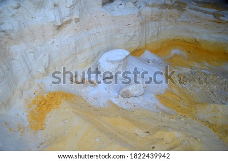 Layers of colored sand. Snow white quartz sand. Shore of Blue Lake in the Chernigow region, Ukraine.Former quarry of quartz sand for glass production.Popular local resort at present #1822439942
