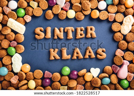 Dutch holiday Sinterklaas background with kruidnoten cookies and traditional hollands sweets. Concept for children party Saint Nicholas day five december with copy space. Top view, overhead. Royalty-Free Stock Photo #1822528517