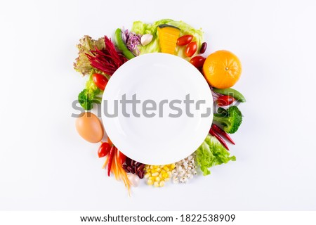 World food day, vegetarian day, Vegan day concept. Top view of fresh vegetables, fruit, with empty plate on white paper background. #1822538909