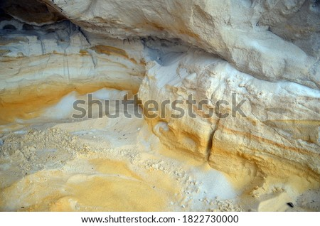 Layers of colored sand. Snow white quartz sand. Shore of Blue Lake in the Chernigow region, Ukraine.Former quarry of quartz sand for glass production.Popular local resort at present #1822730000