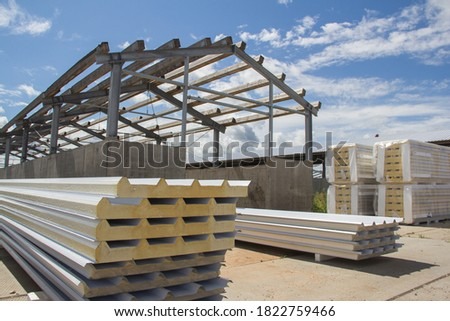 New thermal insulation sandwich panel, construction material for architecture. Sandwich panels at the construction site. New material for insulating the walls of the building under construction. Royalty-Free Stock Photo #1822759466