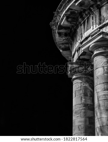 Ancient architecture. The stone temple-cistern of Lucca old aqueduct ruins with doric columns built in neoclassical style in 1823 (Black and white with copy space) Royalty-Free Stock Photo #1822817564