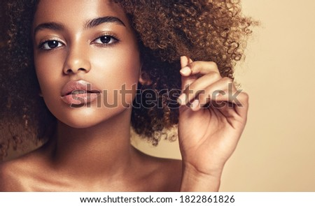 Beauty portrait of African American girl  with afro hair . Beautiful black woman . Cosmetics, makeup and fashion Royalty-Free Stock Photo #1822861826
