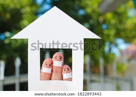Fingers art of family with face mask at home. Royalty-Free Stock Photo #1822893443