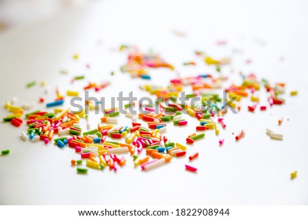 Selective focus colorful sugar sprinkle dots for decoration topping cake and ice cream on the table. Royalty-Free Stock Photo #1822908944