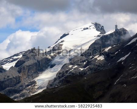 Snowy alpine peaks Titlis and Small Titlis (Klein Titlis) with the eponymous glacier (Titlis-Gletscher) over the Engelbergertal valley Engelberg - Canton of Obwalden, Switzerland (Schweiz) #1822925483