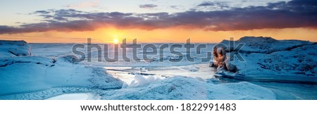 Picturesque panoramic scenery of the snowy Baltic sea shore at sunset,ice fragments close-up. Breathtaking view. Winter seascape. Pure nature, seasons, climate change Royalty-Free Stock Photo #1822991483