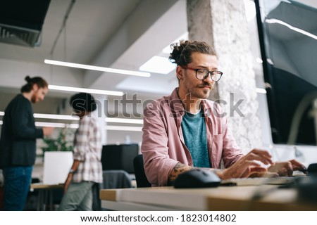 Programmer working and developing software in office Royalty-Free Stock Photo #1823014802