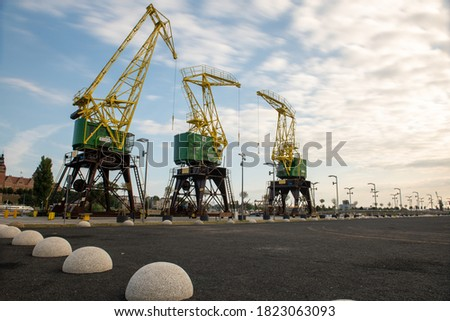 Cityscape with yellow cranes in the background in Szczecin Poland Royalty-Free Stock Photo #1823063093