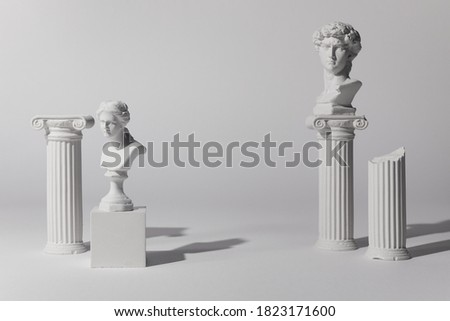 Background for product presentation. Antique columns ans statues on white background Royalty-Free Stock Photo #1823171600