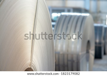 Warehouse of metal coils. Industrial production and logistics concept. Roll of steel sheet in a plant. #1823179082