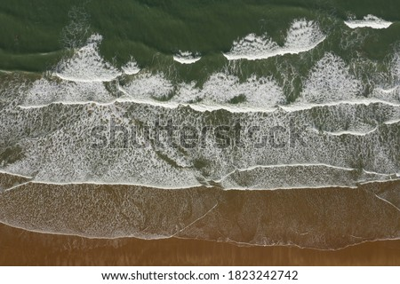 Woolacombe beach in Devon, UK on autumn windy morning Royalty-Free Stock Photo #1823242742