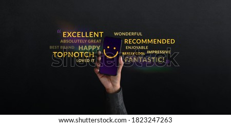 Customer Experiences Concept. person Raised Up a Mobile Phone with Smiling Face Emoticon. Surrounded by Wordings of Positive Review Feedback. Client Satisfaction Surveys #1823247263