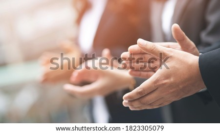 Audience applauding at a business appreciation. People congratulation and clapping hands at conference and presentation.  Royalty-Free Stock Photo #1823305079