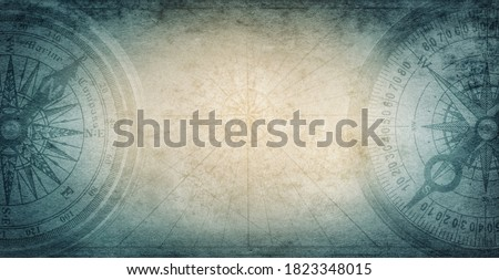 Old compass on vintage paper background. Adventure, discovery, navigation, geography, education, pirate and travel theme concept background. History and geography team. Retro stale.  Royalty-Free Stock Photo #1823348015