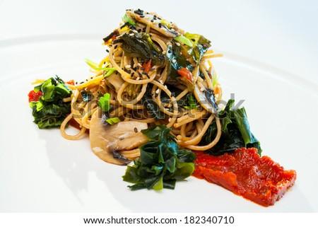 Close up of organic spaghetti with seaweed and mushrooms. #182340710