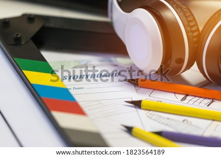 Storyboard Video for Pre-production on film movie. Headphone on slate with color pencil for drawing on sketch board cartoon template layout media, Behind process design creative scene in studio