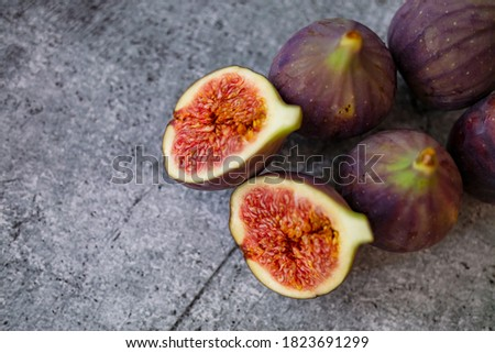 Fresh figs. Food Photo. whole and sliced figs on beautiful rustic background. Fresh Organic Figs.  Healthy Mediterranean fig fruit. Beautiful blue-violet figs with empty copy space close up. #1823691299