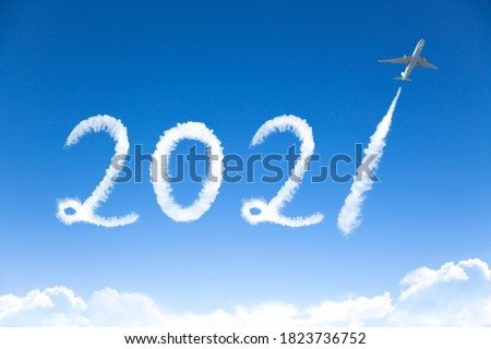 happy New year 2021 concept. cloud drawing by airplane in sky #1823736752
