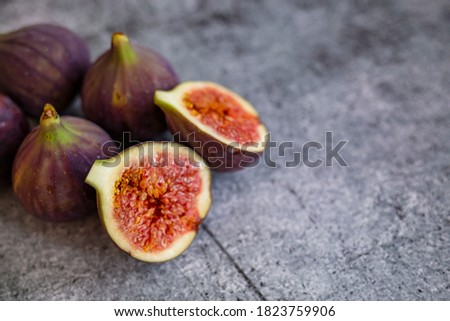 Fresh figs. Food Photo. whole and sliced figs on beautiful rustic background. Fresh Organic Figs.  Healthy Mediterranean fig fruit. Beautiful blue-violet figs with empty copy space close up. #1823759906