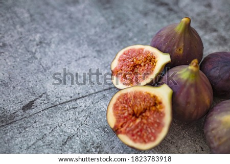 Fresh figs. Food Photo. whole and sliced figs on beautiful rustic background. Fresh Organic Figs.  Healthy Mediterranean fig fruit. Beautiful blue-violet figs with empty copy space close up. #1823783918