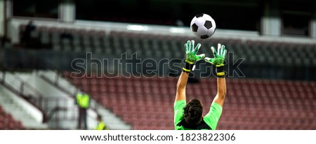 soccer game background goalkeeper catching football