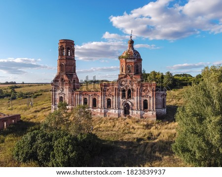ancient abandoned and ruined church, dilapidated red brick temple, abandoned red brick temple illuminated by the setting sun, an abandoned church at sunset, abandoned church of the Annunciation, fligh #1823839937