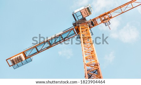 Construction crane on the background of the sky. Construction site #1823904464